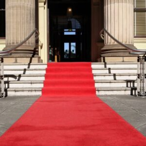 Red carpet laid in front of a Georgian or Regency stone building